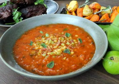 Fresh tomato and herb soup with lentils and sautéed bacon